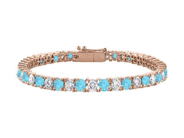 Created Blue Topaz and Cubic Zirconia Tennis Bracelet in 14K Rose Gold Vermeil. 7 CT TGW. 7 Inch