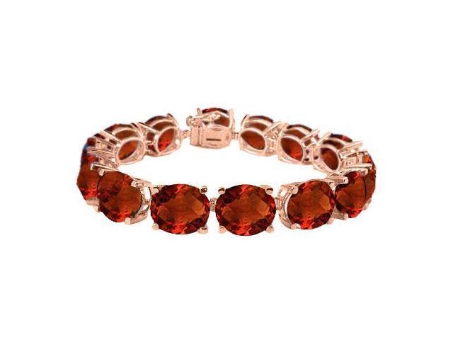 Garnet Tennis Bracelet Oval Cut in 14K Rose Gold Vermeil. 50 CT. TGW. 7 Inch