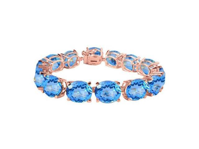 Created Blue Topaz Tennis Bracelets Oval Cut in 14K Rose Gold Vermeil. 50 CT. TGW. 7 Inch