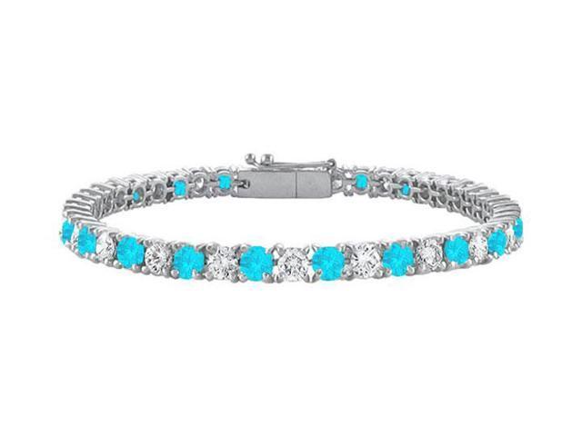 Blue Topaz and Cubic Zirconia Prong Set 10K White Gold Tennis Bracelet 4.00 CT TGW