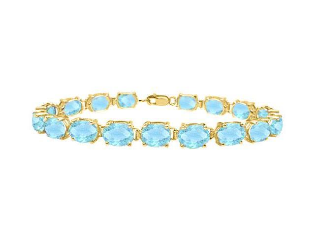Tennis bracelets oval cut created aquamarine in sterling silver vermeil 18K yellow gold 15ct TGW