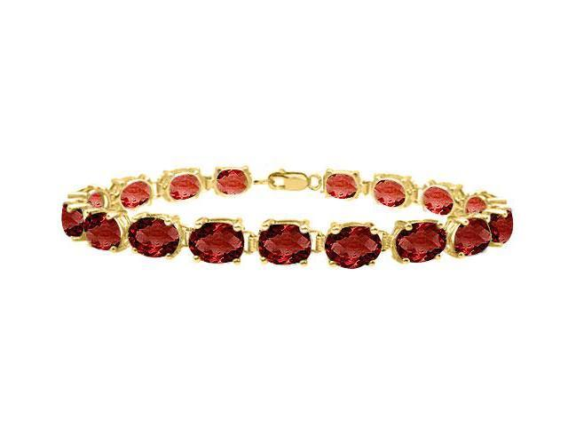 Garnet tennis bracelet oval cut prong set in sterling silver vermeil 18K yellow gold 15ct TGW