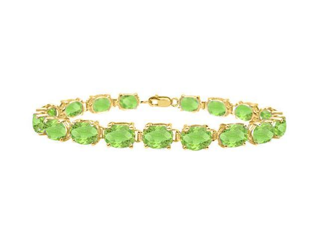 Bracelets tennis peridot oval cut prong set 18K yellow gold vermeil in sterling silver 15ct TGW