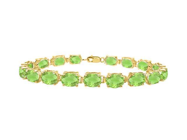 Bracelets tennis peridot oval cut prong set 18K yellow gold vermeil in sterling silver 15ct TGW