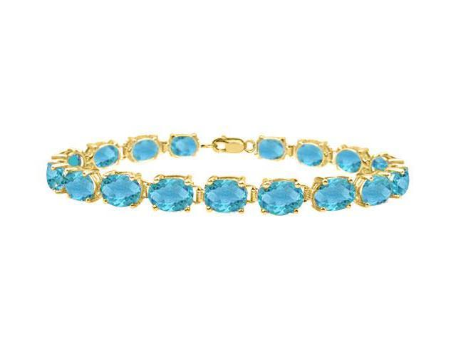Tennis bracelets oval cut created blue topaz in sterling silver 18K yellow gold vermeil 15ct TGW