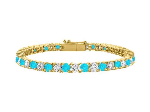 CZ and Created Blue Topaz Tennis Bracelet in 18K Yellow Gold Vermeil. 4CT. TGW. 7 Inch