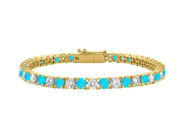 Created Blue Topaz and CZ Tennis Bracelet in 18K Yellow Gold Vermeil. 5 CT. TGW. 7 Inch