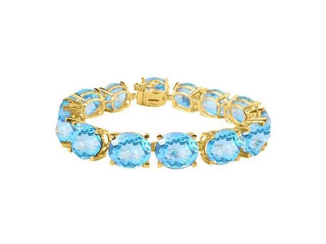 Tennis bracelets of created Aquamarine oval cut in 18K Yellow Gold Vermeil. 50CT. TGW. 7 Inch