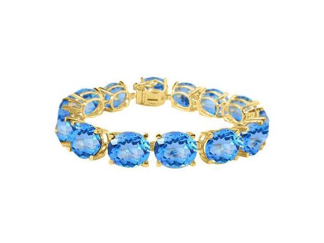 Tennis Bracelets Created Blue Topaz Oval Cut  in 18K Yellow Gold Vermeil.50CT. TGW. 7 Inch