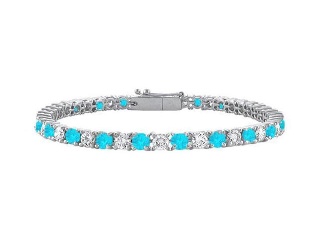 Sterling Silver Round Blue Topaz and Cubic Zirconia Tennis Bracelet 2.00 CT TGW