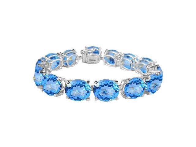 Sterling Silver Prong Set Oval Blue Topaz Bracelet with 50.00 CT TGW