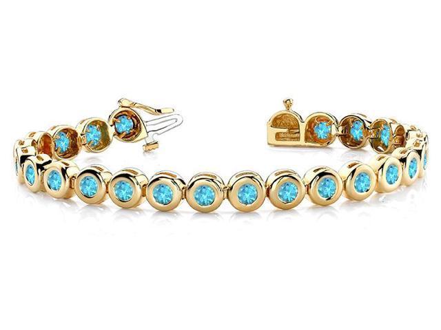 Created Blue Topaz Tennis Bracelet in 14K Yellow Gold. 10.50 ct.tw.