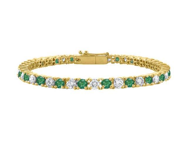 Cubic Zirconia and Created Emerald Tennis Bracelet in 18K Yellow Gold Vermeil. 2 CT. TGW. 7 Inch