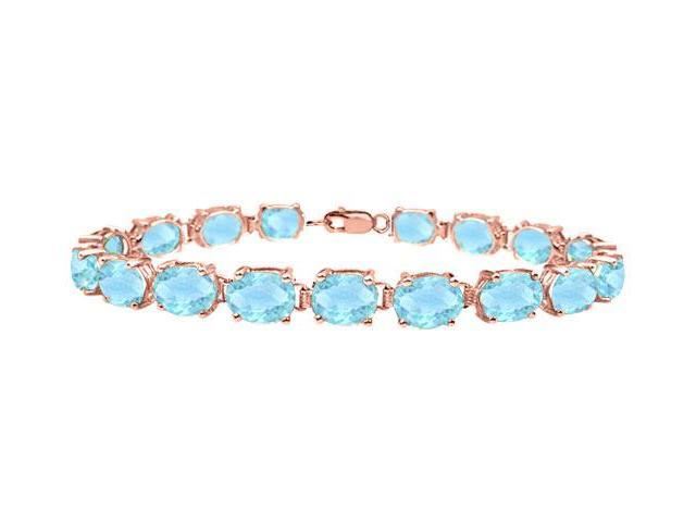 Tennis bracelets oval cut created aquamarine in 14K Rose gold Vermeil. 15 CT. TGW. 7 Inch