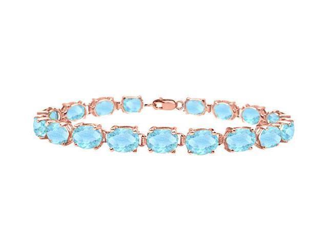 Tennis bracelets oval cut created aquamarine in 14K Rose gold Vermeil. 15 CT. TGW. 7 Inch