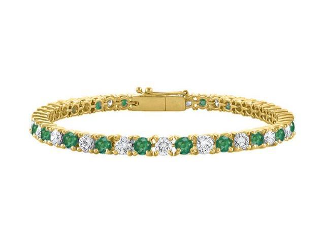 Cubic Zirconia and Created Emerald Tennis Bracelet in 18K Yellow Gold Vermeil. 5 CT. TGW. 7 Inch