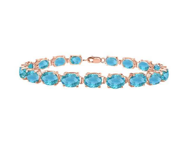 Tennis bracelets oval cut created blue topaz in 14K rose gold vermeil. 15 CT. TGW. 7 Inch