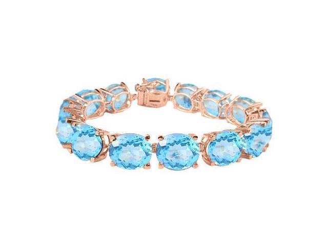 Tennis Bracelets Of Created Aquamarine Oval Cut in 14K Rose Gold Vermeil. 50CT. TGW. 7 Inch