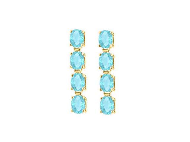 Totaling Five Carat Oval Cut Aquamarine Drop Earrings in Sterling Silver 18K Yellow Gold Vermeil