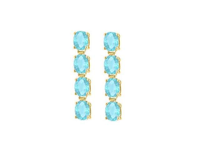 Totaling Eight Carat Oval Cut Aquamarine Drop Earrings in 14K Yellow Gold Prong Setting