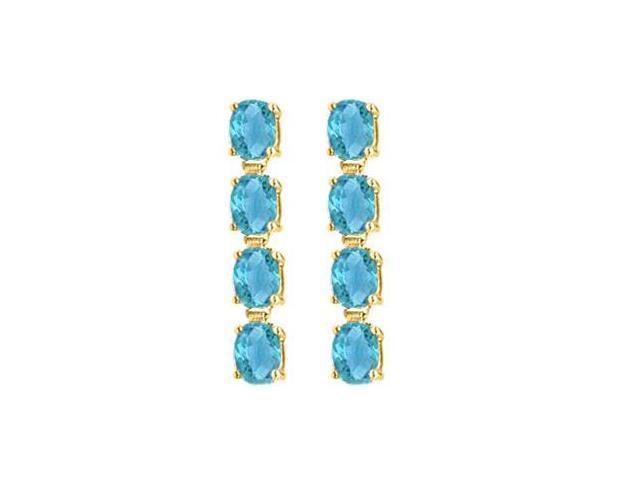 Oval Created Blue Topaz Drop Earrings in 14K Yellow Gold Totaling Gem Weights of Eight Carat
