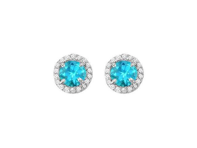 December Birthstone Blue Topaz and Cubic Zirconia Halo Stud Earrings in Sterling Silver
