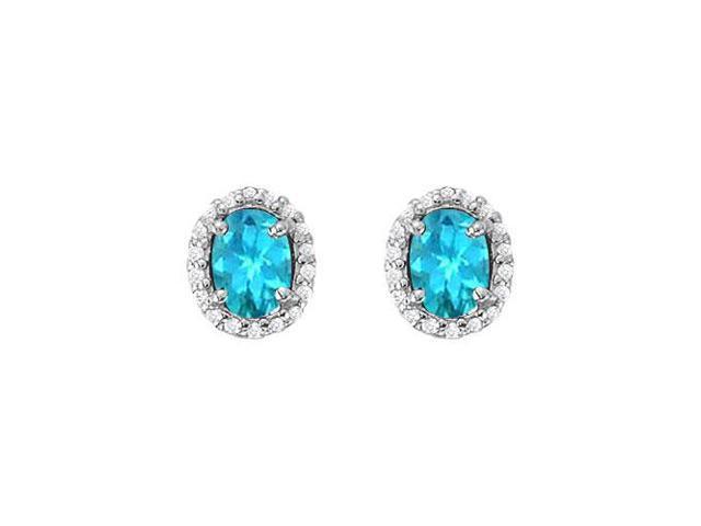 December Birthstone Blue Topaz and Cubic Zirconia Halo Stud Earrings in Sterling Silver 6 CT TGW