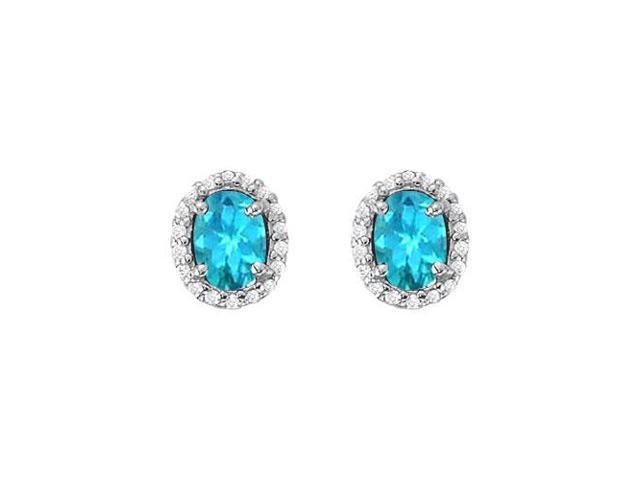 December Birthstone Created Blue Topaz and CZ Halo Stud Earrings in 14kt White Gold 6.00 CT TGW