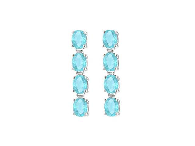 Totaling Eight Carat Oval Cut Created Aquamarine Drop Earrings in 14K White Gold Prong Setting