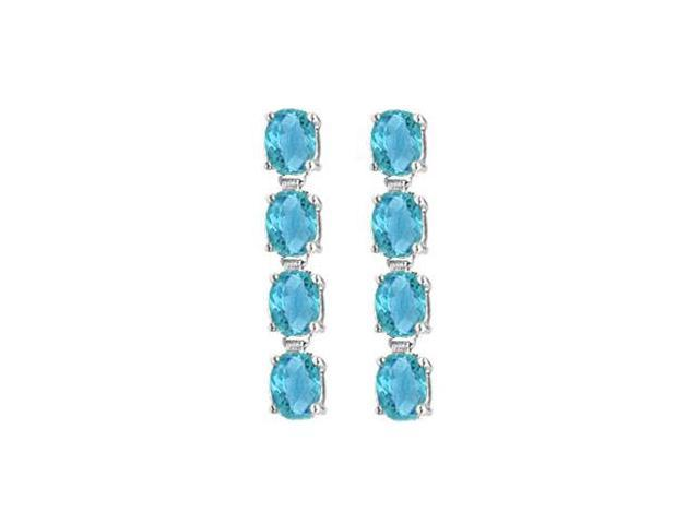 Oval Created Blue Topaz Drop Earrings in 14K White Gold Totaling Gem Weights of Eight Carat