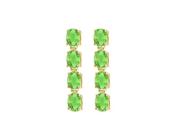 Eight Carat Totaling Gem Weights of Oval Peridot Drop Earrings in 14K Yellow Gold Prong Setting