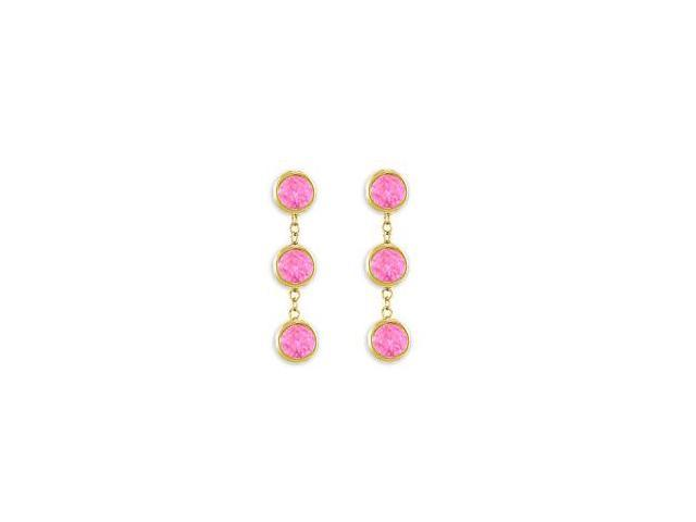 Totaling Six Carat Pink Sapphire Drop Station Earrings in 14K Yellow Gold Bezel Setting