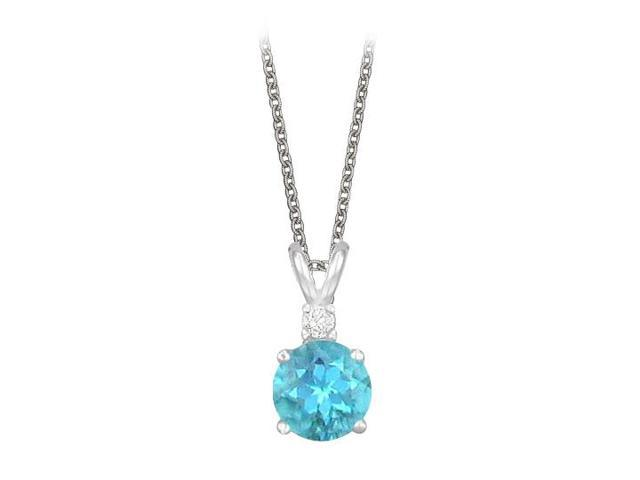Round Cut Created Blue Topaz and Cubic Zirconia Pendant Necklace in Sterling Silver. 1.02.ct.tw.