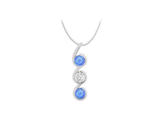 3 stone pendant of created sapphire with white CZ in 14K white gold total gem weight of 1.20 car