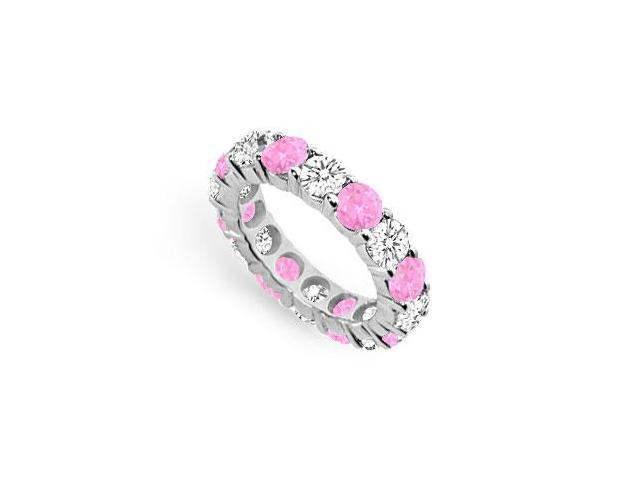Created Pink Sapphire and CZ Eternity Band in Sterling Silver Seven Carat TGW.