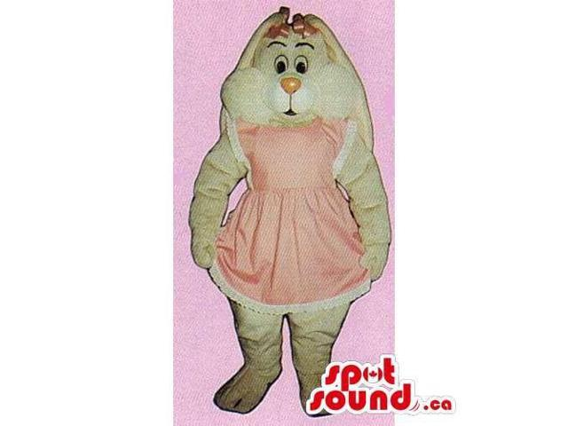 Customised Beige Rabbit Canadian SpotSound Mascot Dressed In A Pink Dress And Ribbons