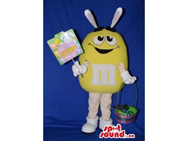 Yellow M&M'S Chocolate Canadian SpotSound Mascot With Rabbit Ears And Basket