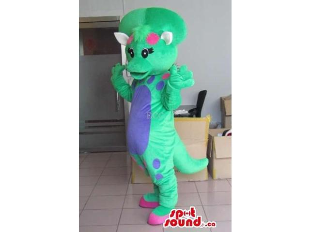 Green Dinosaur Canadian SpotSound Mascot With A Blue Belly And A Bone