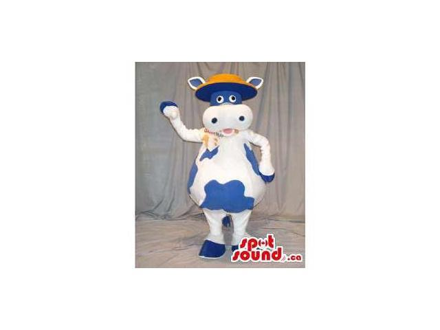 Blue And White Cow Animal Canadian SpotSound Mascot Dressed In A Flat Hat