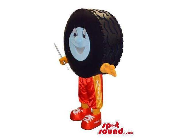 Large Car Wheel Tire Canadian SpotSound Mascot With A Face Dressed In Orange Pants