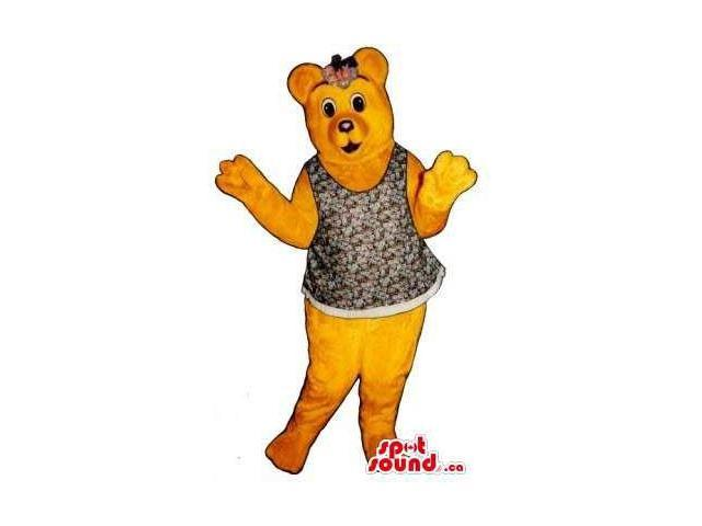 Brown Girl Bear Canadian SpotSound Mascot Dressed In A Dress And A Ribbon