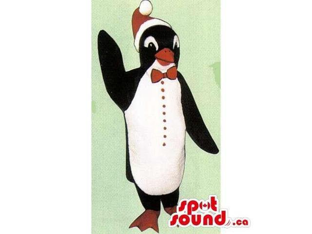 Cute Penguin Canadian SpotSound Mascot Dressed In A Christmas Hat And A Bow Tie