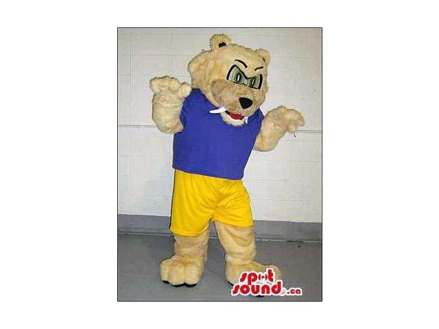 Beige Angry Bear Canadian SpotSound Mascot Dressed In A Blue T-Shirt And Yellow Shorts