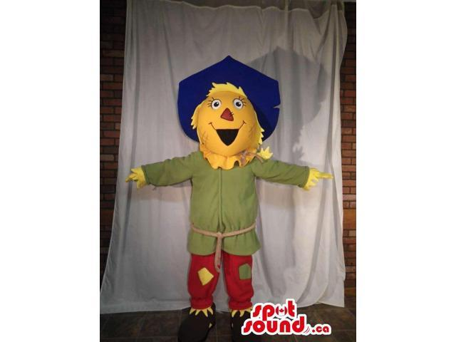 Scarecrow Character Canadian SpotSound Mascot Dressed In A Blue Hat And Red Pants