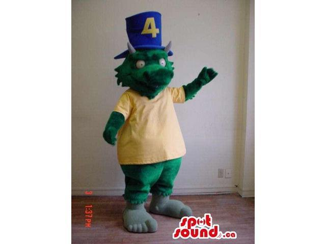 Green Dragon Canadian SpotSound Mascot Dressed In A Yellow T-Shirt And A Blue Top Hat
