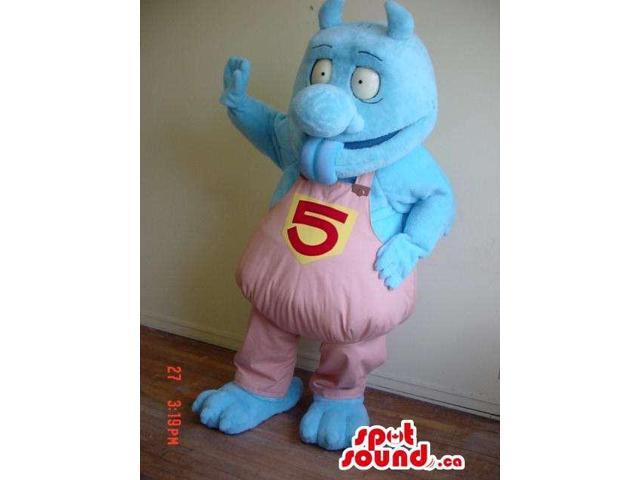 Blue Monster Canadian SpotSound Mascot Dressed In Pink Overalls With Number 5