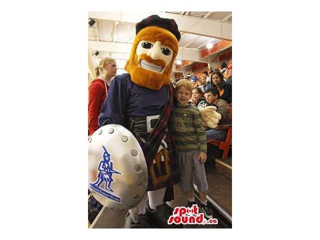 Scottish Human Canadian SpotSound Mascot With Red Beard, Shield And A Kilt