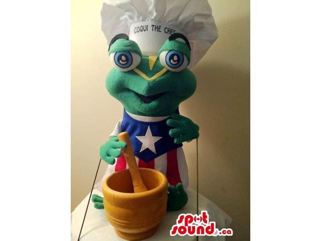 Cute Green Frog Canadian SpotSound Mascot Dressed In A Cuban Flag And Chef Hat