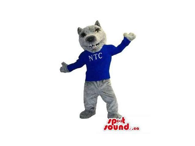 Grey Wolf Canadian SpotSound Mascot Dressed In A Blue T-Shirt With Letters
