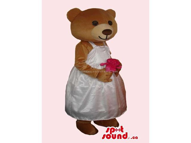 Brown Bear Girl Canadian SpotSound Mascot With Flower Dressed In A White Dress